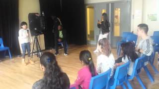 Fatima singing &#39Never Say Never&#39 in a fun fair held in Abraham Moss school Manchester - UK