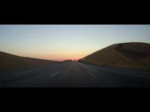 Driving on Interstate 580 during sunrise in California