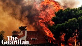 Devastating wildfires rage around Athens