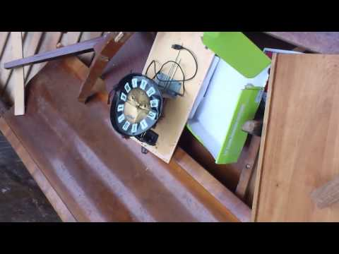 antique clock and Art Deco furniture in garbage......