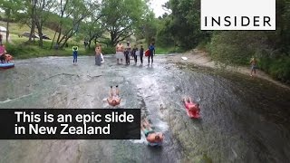 This rock in New Zealand is basically an epic Slip 'N Slide