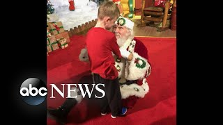 Santa helps blind child experience the magic of Christmas