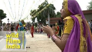 Indian Punjabi girls perform Gidda dance at Wagah border on Independence day