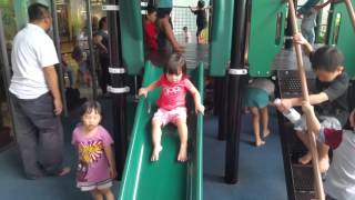 20-month-old toddler learning how to slide