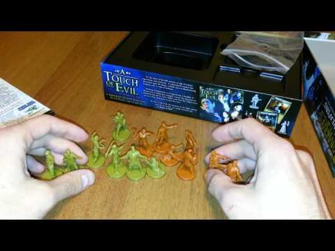 Распаковка настольной игры - Last Night On Earth: Zombies With Grave Weapons Miniature Set