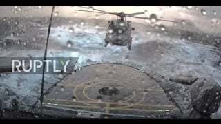 Denmark: Helicopter braves extreme North Sea conditions to land on moving war ship