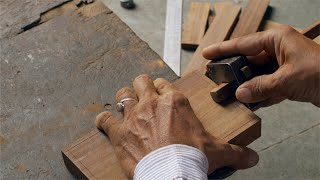 Tarkashi - A worker making the design on a piece of wood with marking gauge