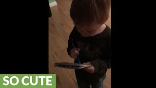 Precious toddler helps mom with the grocery list