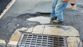 Oblivious Drivers Hit Massive Pothole