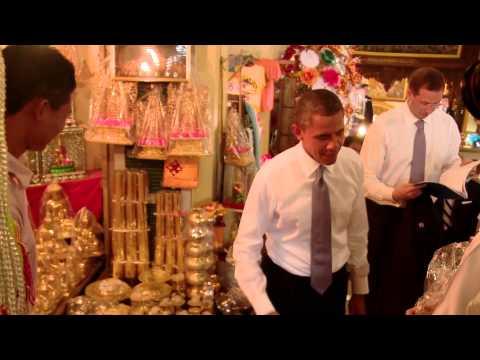 Obama Surprises Store Clerk In Asia