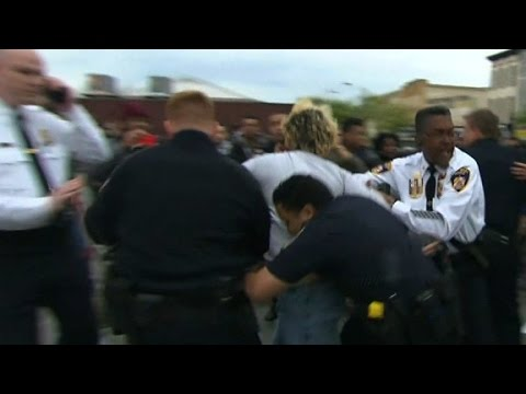 Baltimore police, protesters clash