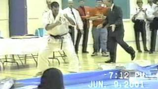 Denis Cordeiro from Kanreikai karate breaks 10 pieces of ice