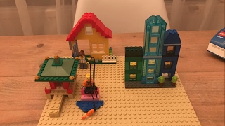 Building Lego houses in a stop motion time lapse