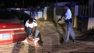 Accion di Polis cu Persecusion y Detencion despues di tiramento den Canoastraat