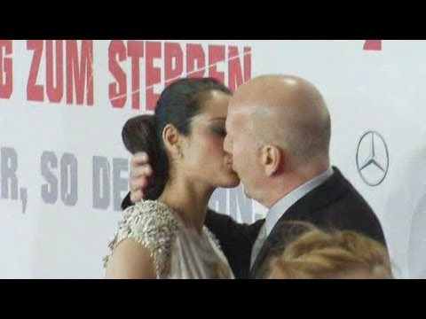 Bruce Willis gets steamy with his wife at the premiere of A Good Day To Die Hard in Berlin