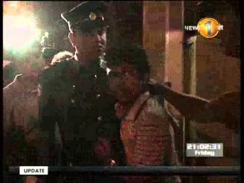 Police disperse a candle-light vigil in Colombo - Part 1