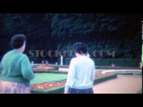 1963: Women visits Roman Italian wealthy manicured garden grounds.  ROME, ITALY