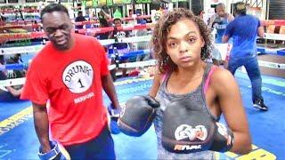 Czarina McCoy padwork with Jeff Mayweather inside the Mayweather Boxing Club