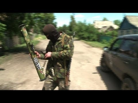 Fighting continues in eastern Ukraine despite cease-fire