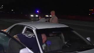 Driver passed out behind the wheel inside car stopped in middle of San Diego freeway