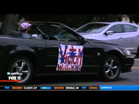 LAPD Slowly Chase Man In Convertible With 'Victory Parade' Sign