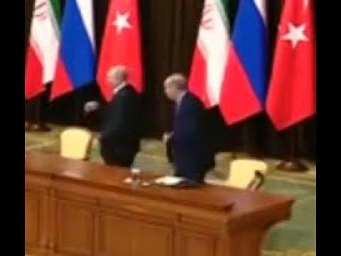 Путин уронил стул Эрдогана. Путин выхватил стул и уронил его.