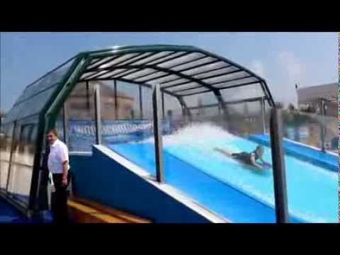 Un abri piscine venus pour une ecole de surf youtube for Abris de piscine venus international