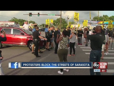 Protesters block traffic in Sarasota for police brutality march