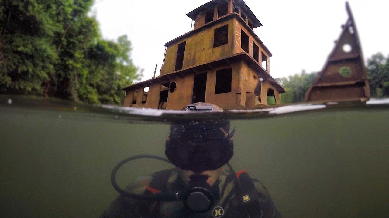 Scuba diving half sunken tug boat in river explored for for Finding a builder