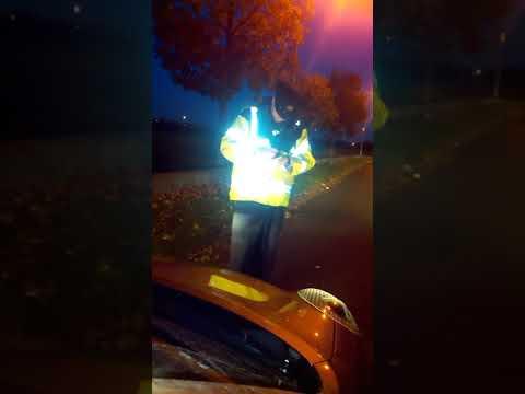 Garda Smashes Car Window at Checkpoint