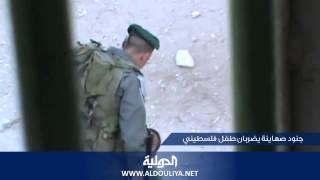 Repeat youtube video Israeli soldiers beating a Palestinian childجنود صهاينة يضربان طفل فلسطيني
