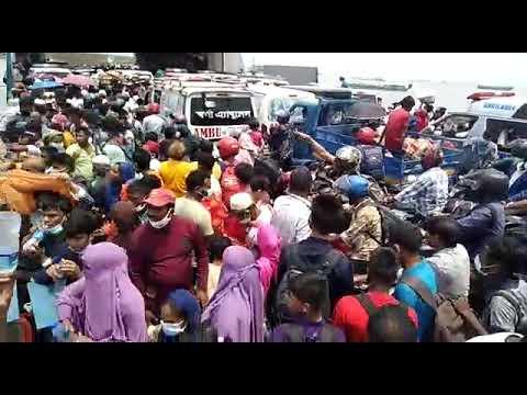 মাওয়া শিমুলিয়া ফেরিতে স্বাস্থ্য বিধি না মেনে ঘরে ফেরা মানুষের ঢল