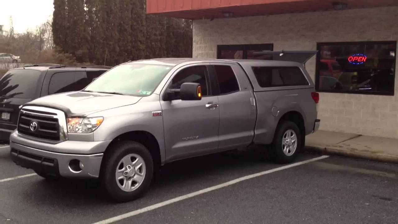 2012 toyota tundra with a.r.e. cx cap, bedrug, and lightbar - youtube