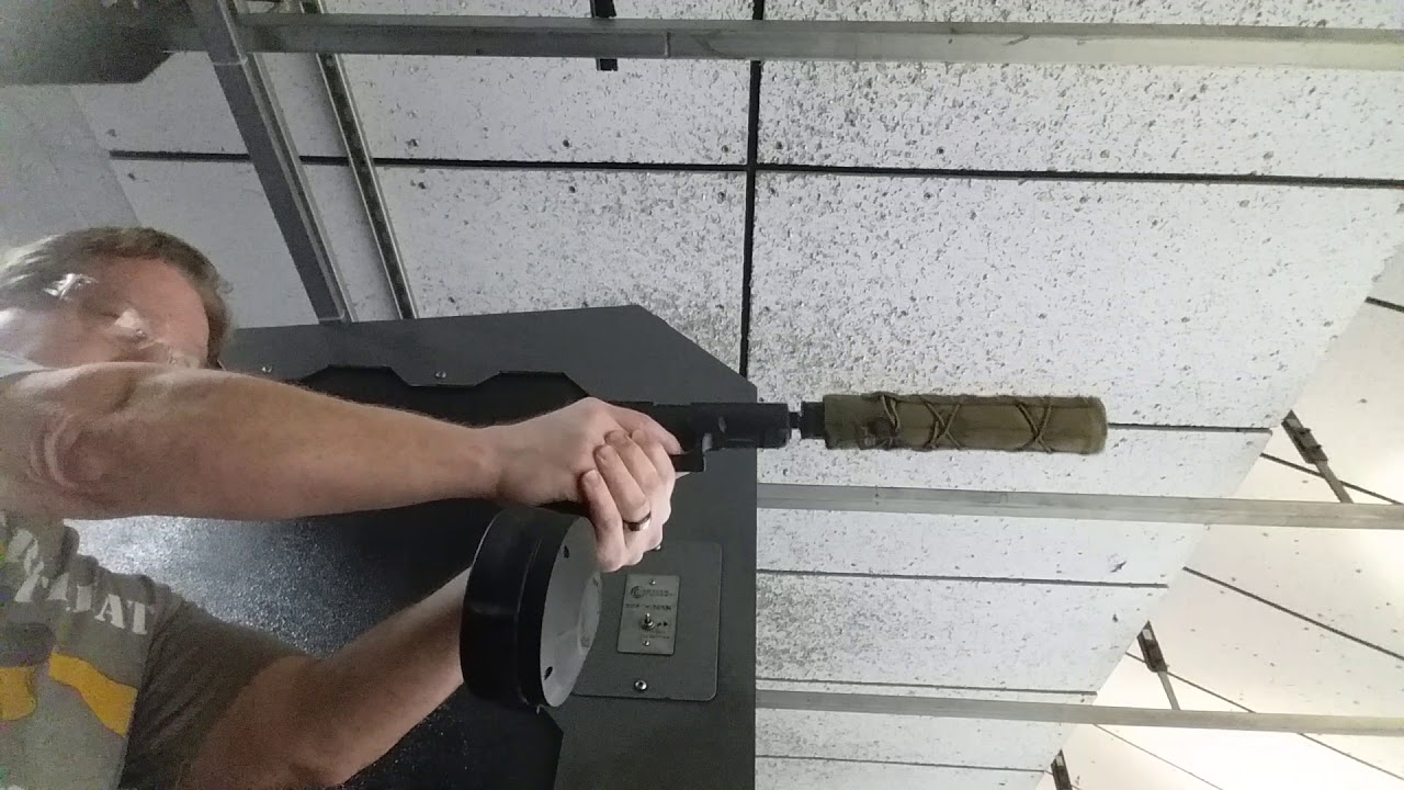 ProMag 50 round drum in suppressed Glock 22 with 9mm conversion Barrel