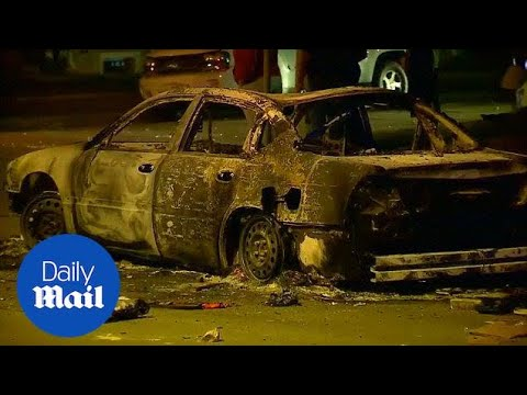 Violence erupts in Milwaukee after police shoot man dead - Daily Mail