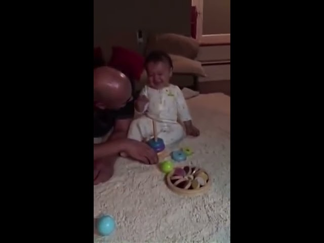 Baby can't stop laughing playing with his toy