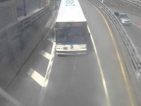 X27 bus under Hugh Carey Tunnel Pedestrian Bridge