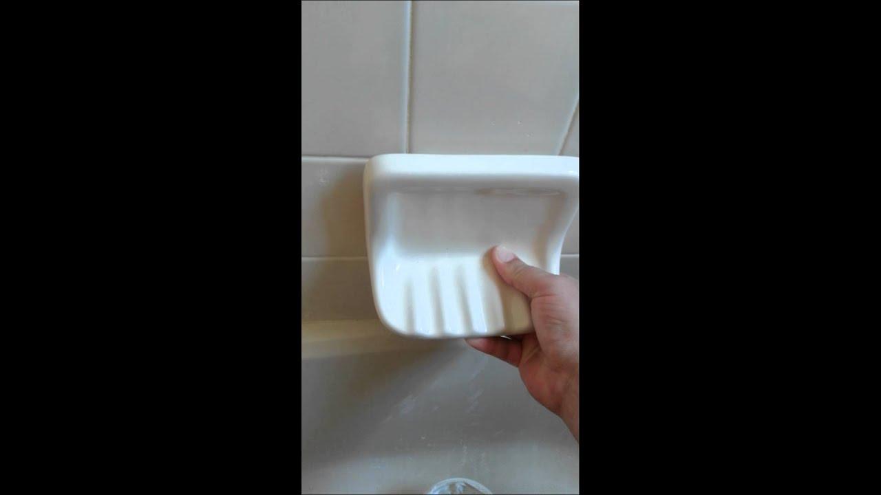 xander fixing a soap dish