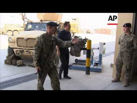 British PM David Cameron makes unscheduled surprise visit to Camp Bastion