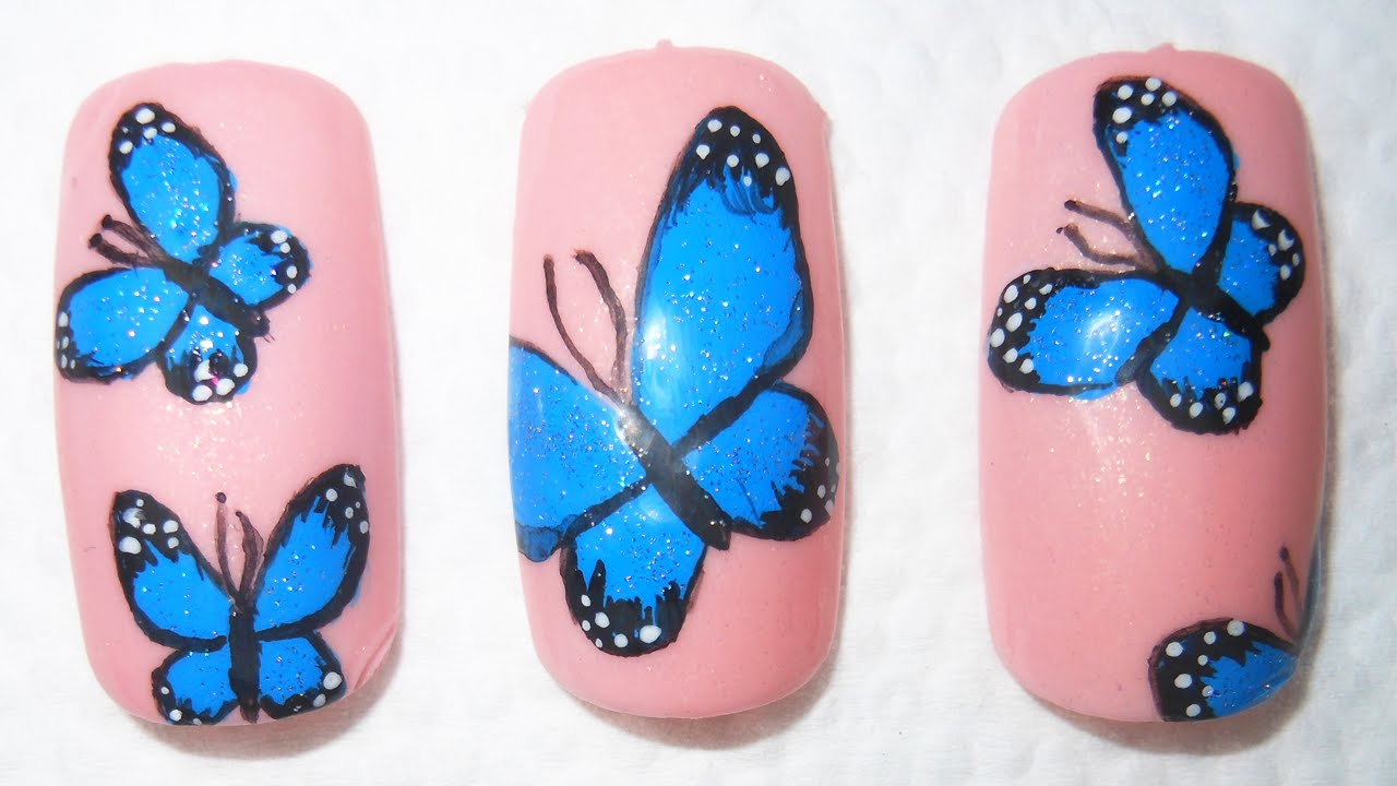 beautiful blue butterfly nail design