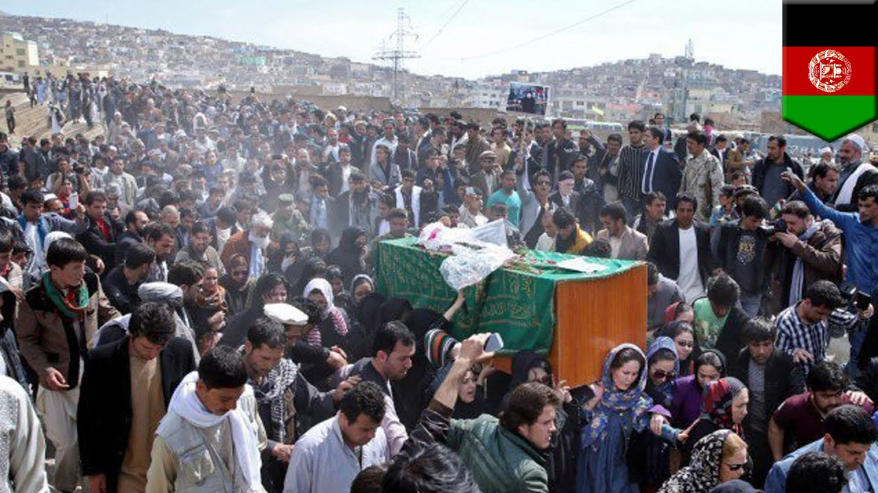 Afghan woman beaten, dragged and burned after falsely accused of burning Koran