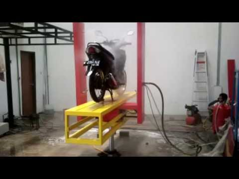 Automatic motorcycle wash- with Hydraulic. ,PATENT.