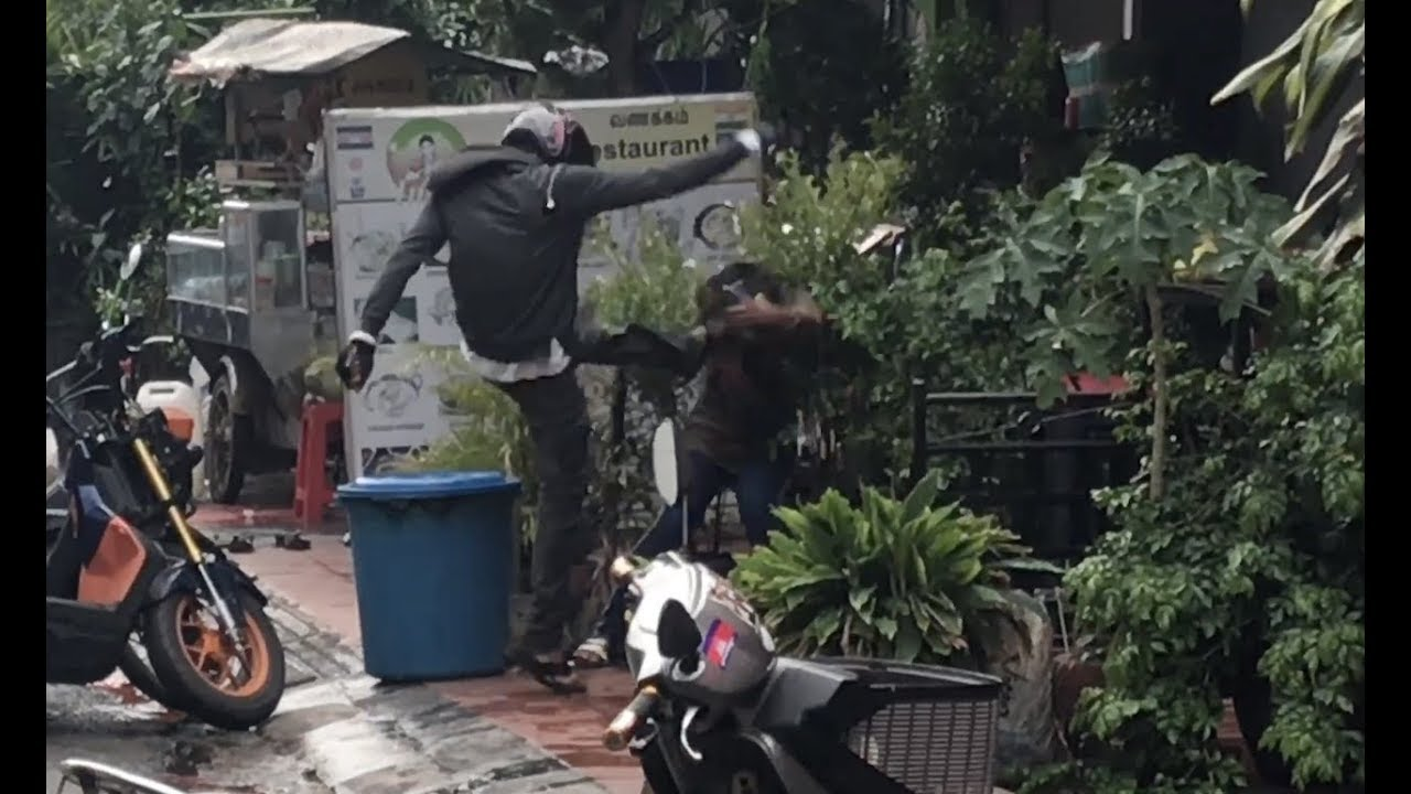 Download Guy Beats Woman Outside Bar In Cambodia