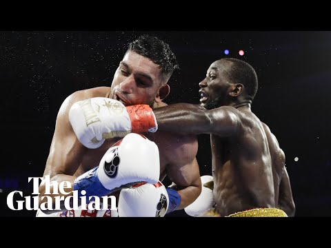 Terence Crawford retains title when Amir Khan can't continue after low blow
