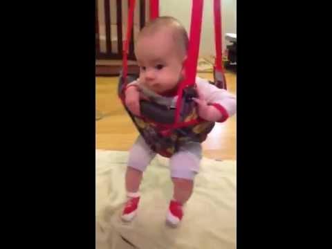 Baby Bradley Christian on a doorway jumper swing