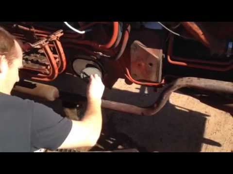 How to change hydraulic filter on 606 international tractor - YouTube