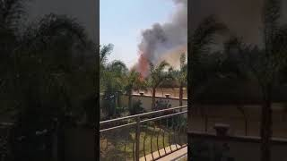 Fire burns veld along the Braamfontein Spruit in Bryanston