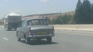 بيجو 404  انى 1965تسير بسرعة 190 كلم / سا تناقر في لمتريال لخشين  بمدينة شلغوم العيد