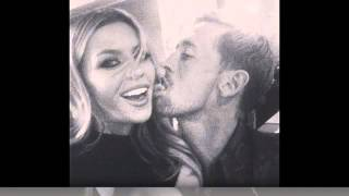 Abbey Clancy and Stoke striker Peter Crouch pucker up for the camera