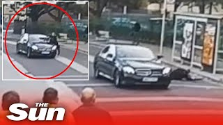 Driver mows down armed police officer leaving him 'scared for his life'